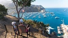 Catalina Island, Chanel Islands National Park, California, Casino View. Pier View. Mother and Son. Family. USA Flag. Boats.