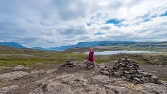 Iceland Travel, Ring Road. Cloudscape. Mountains View. Traveler. Explorer.