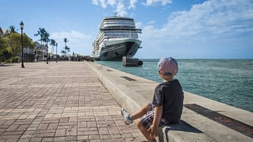 Key West, FL. Cruise Ship, Port. Sunset Pier. Boy Sitting and watching.